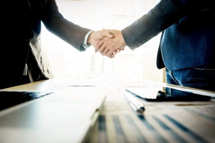 Businesspeople shaking hands - learn hebrew